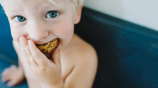 child eating snack