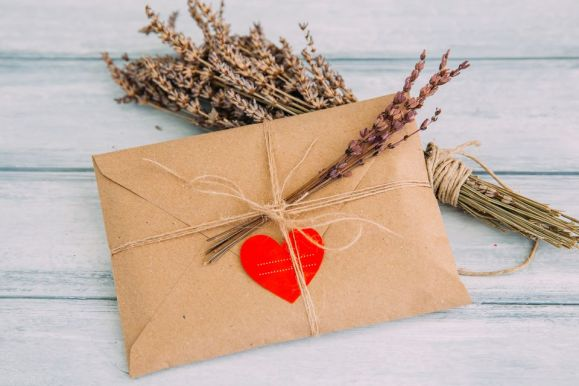 envelope-with-heart-sticker-and-dried-flowers-709118369-5a6363404e46ba003741167d